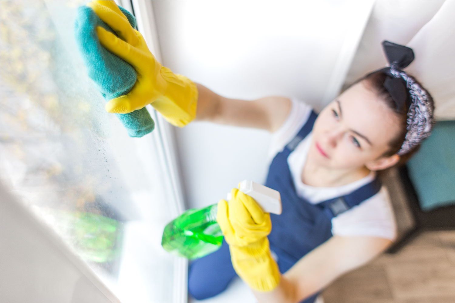 a young woman cleaning a window